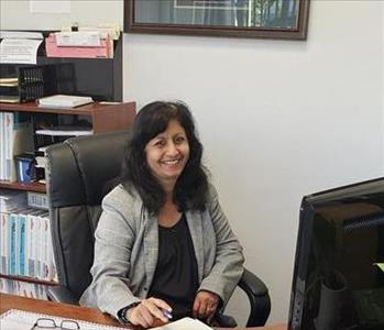 Our smiling face female Office Assistant greeting at front desk