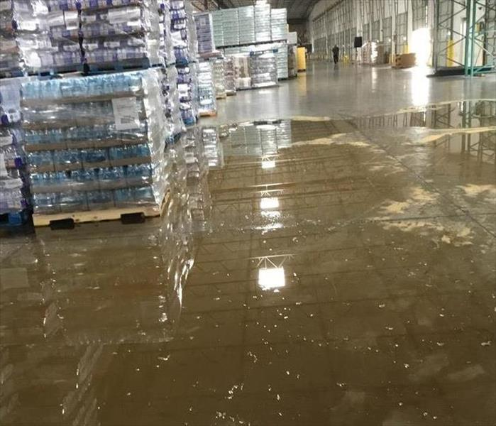Almost two inches of water on floor and under the pallets in warehouse